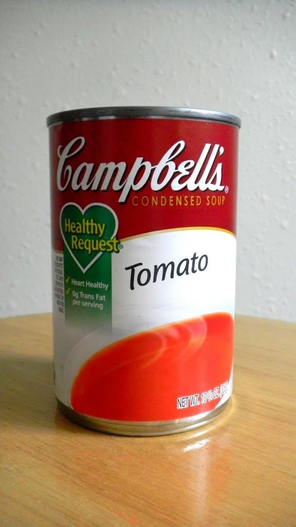 Can of Campbell's Tomato Soup on wood surface