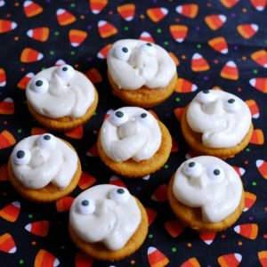 Pumpkin Ghost Cupcakes from A Duck's Oven. These mini pumpkin ghost cupcakes are adorable for Halloween (or any other reason!) and so easy to make!