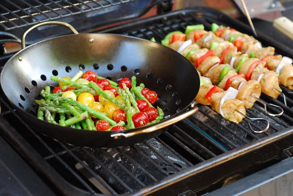 chicken kebabs and vegetables on the grill