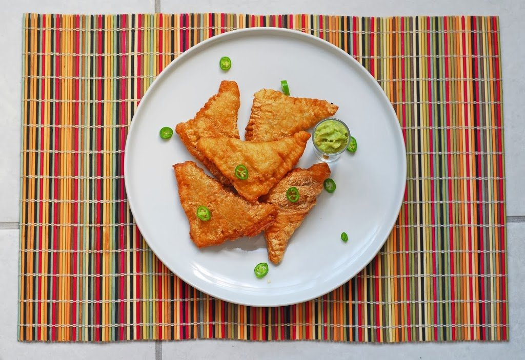 Lamb Samosas from A Duck's Oven. Samosas stuffed with spiced lamb and dipped in an avocado sauce.
