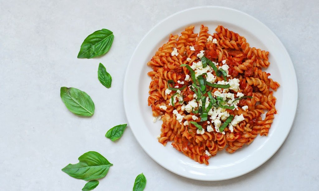 Meaty Fusilli with Basil and Feta from A Duck's Oven. Our absolute favorite pasta! Fusilli in a tomato sauce with ground beef and sausage, topped with fresh basil and feta cheese.