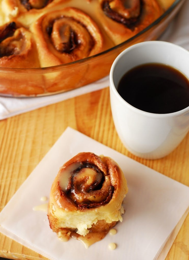 Bacon stuffed cinnamon roll with cup of coffee