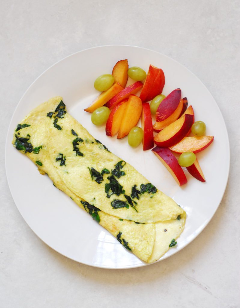Spinach and Feta Omelette from A Duck's Oven. This breakfast is easy to whip together, healthy, and filling. Only 309 calories!