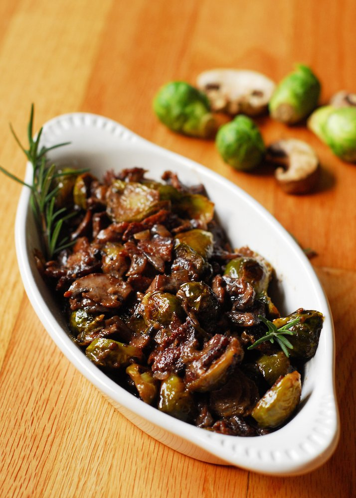 Brussels Sprouts and Mushrooms in Rosemary Red Wine Cream Sauce from A Duck's Oven. Brussels sprouts, bacon, and mushrooms tossed together in a garlicky rosemary red wine cream sauce. A great way to liven up these veggies!