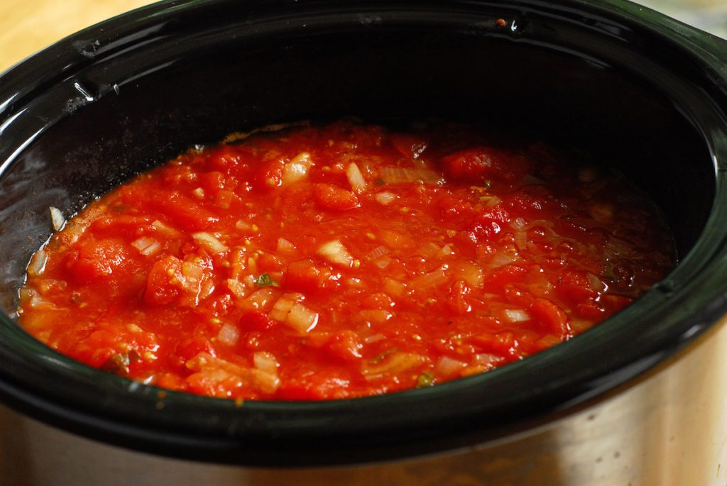 Cooked tomato soup ingredients in crock pot