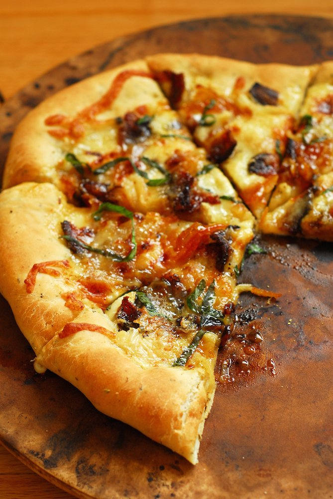 Brie, Bacon, and Orange Pizza with Truffle Oil from A Duck's Oven. The perfect salty + sweet combo that's fancy but not too difficult to make!