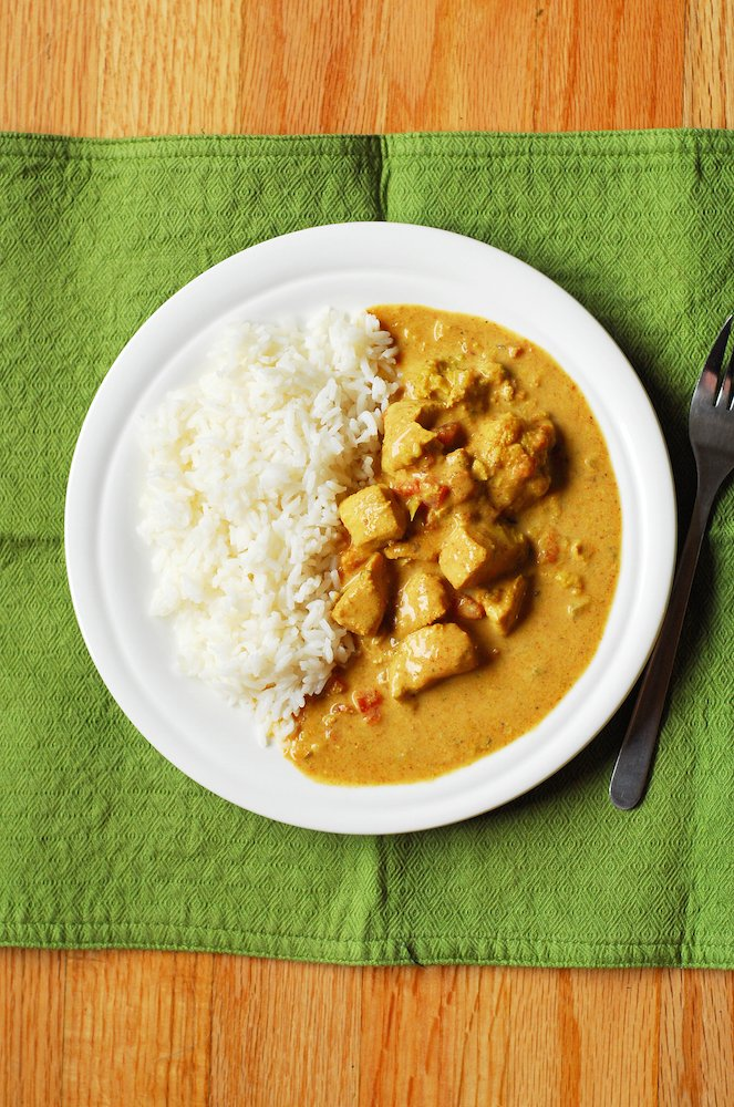Crockpot Coconut Chicken & Veggie Curry from A Duck's Oven. A simple and flavor-packed curry made easy in your crockpot!