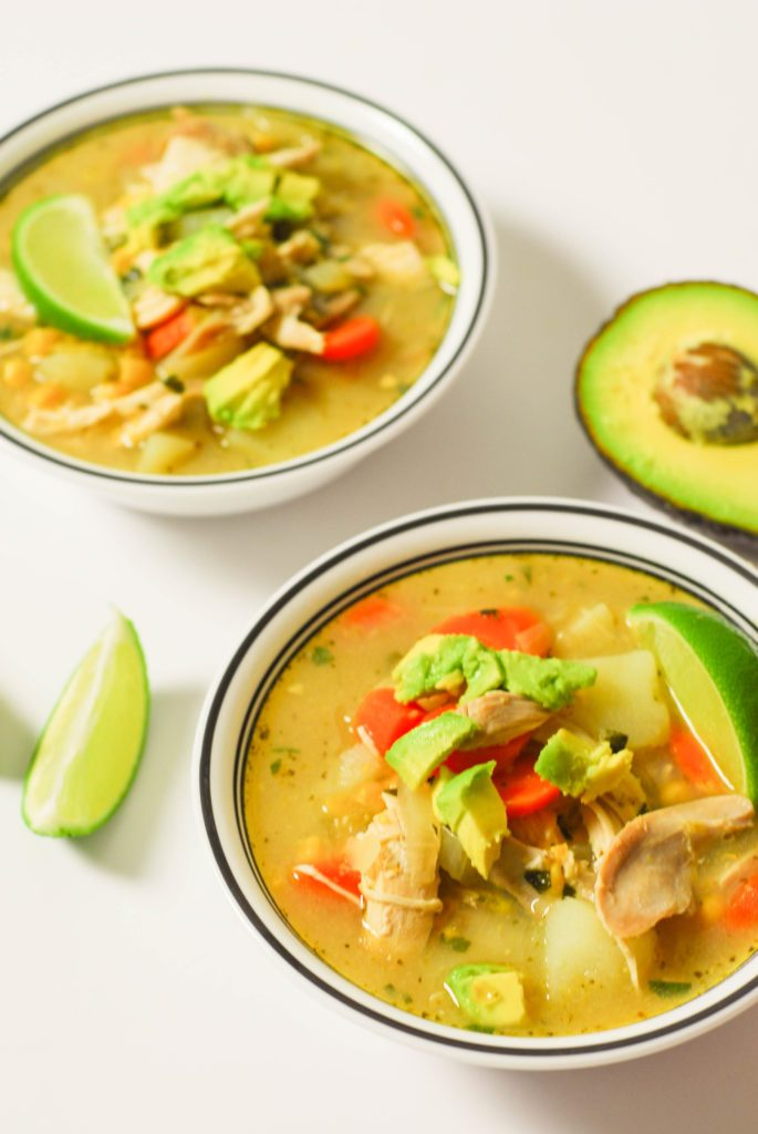 Colombian Chicken Soup from A Duck's Oven. A little spicy, a lot fresh, topped with plenty of avocado.