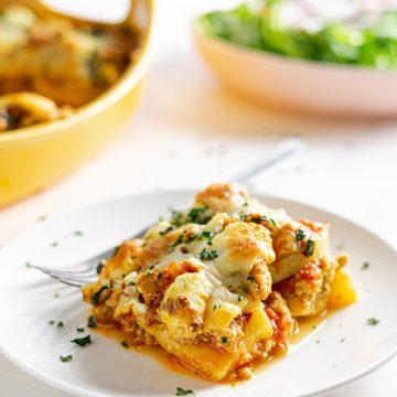 Slice of polenta lasagna on plate