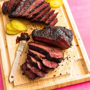 Sous vide beef brisket sliced on wood cutting board