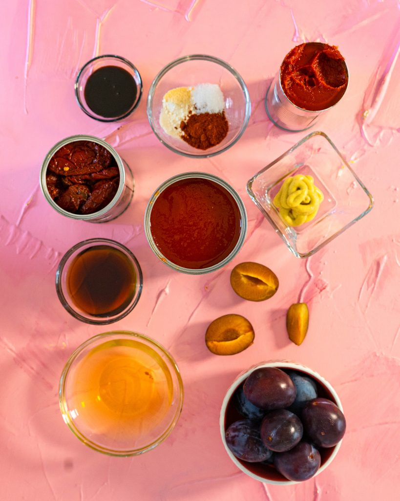 Plum bbq sauce ingredients on pink surface