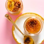 Pumpkin creme brulee in jars on pink surface