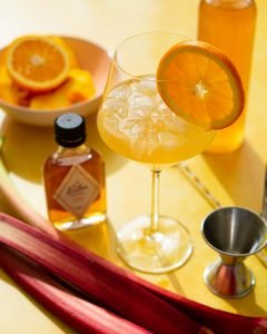 Cocktail ingredients on yellow background